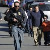 Parents leave a staging area after being reunited with their children following a shooting at the Sandy Hook Elementary School in Newtown, Conn., about 60 miles (96 kilometers) northeast of New York City, Friday, Dec. 14, 2012. An official with knowledge of Friday\'s shooting said 27 people were dead, including 18 children. It was the worst school shooting in the country\'s history. (AP Photo/Jessica Hill)