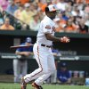 Baltimore Orioles\' Delmon Young follows through on a double against the Toronto Blue Jays in the first inning of a baseball game on Sunday, April 13, 2014, in Baltimore. (AP Photo/Gail Burton)