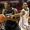 OU\'s Sharane Campbell (24) tries to steal the ball from Vanderbilt\'s Tiffany Clarke (34) in the first half during a women\'s college basketball game between the University of Oklahoma Sooners and the Vanderbilt Commodores at Lloyd Noble Center in Norman, Okla., Sunday, Dec. 16, 2012. Photo by Nate Billings, The Oklahoman