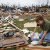 Administrative assistant LaDonna Cockerham sieved through the debris of her office at the Little Axe School Central Office, Tuesday, May 11, 2010. The school was hit by a tornado Monday, May 10, 2010. Photo by David McDaniel, The Oklahoman