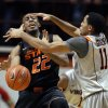 Virginia Tech guard Erick Green (11) and Oklahoma State guard Markel Brown (22) battle for the ball during the second half of an NCAA college basketball game in Blacksburg, Va., Saturday, Dec. 1, 2012. (AP Photo/Daniel Lin) ORG XMIT: VADL115