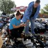 Volunteer Shelby Hays helps tornado victim Amber Kelley choose shoes for her children outside the Plaza Towers neighborhood in Moore, Okla., on Wednesday, May 22, 2013.A tornado damaged the area on Monday, May 20, 2013. Photo by Bryan Terry, The Oklahoman