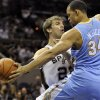Denver Nuggets center JaVale McGee, right, blocks a pass-attempt by San Antonio Spurs center Tiago Splitter, of Brazil, during the first half of an NBA preseason basketball game on Friday, Oct. 12, 2012, in San Antonio. (AP Photo/Bahram Mark Sobhani)