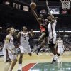 Photo -   Toronto Raptors' Ben Uzoh (18) goes up for a shot against Milwaukee Bucks' Ekpe Udoh during the first half of an NBA basketball game Monday, April 23, 2012, in Milwaukee. (AP Photo/Morry Gash)
