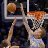 Denver\'s Chris Andersen (11) blocks a shot by Oklahoma City\'s Russell Westbrook (0) during the first round NBA playoff game between the Oklahoma City Thunder and the Denver Nuggets on Sunday, April 17, 2011, in Oklahoma City, Okla. Photo by Chris Landsberger, The Oklahoman
