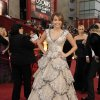 ** LINDA MILLER\'S COMMENTARY: Would like to have seen this gown on someone else. Too much gown for a 16-year-old. One of my least-favorite gowns ** Singer Miley Cyrus arrives for the 81st Academy Awards Sunday, Feb. 22, 2009, in the Hollywood section of Los Angeles. (AP Photo/Chris Pizzello) ORG XMIT: CABG116