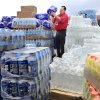 Melvin Potter lifts a case of bottled water from a pallet of supplies donated by local merchants in Tecumseh. Potter is emergency management director for the city of Tecumseh. Wednesday, May 12, 2010. The water is among supplies and building materials being made available to victims of Monday night\'s tornado that damaged or destroyed numerous homes in Pottawatomie County. Photo by Jim Beckel, The Oklahoman