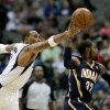 Photo - Dallas Mavericks forward Shawn Marion, left, attempts to steal the ball away from Indiana Pacers' C.J. Watson (32) in the first half of a preseason NBA basketball game, Friday, Oct. 25, 2013, in Dallas. (AP Photo/Tony Gutierrez)