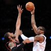New York Knicks\' Amare Stoudemire, right, shoots over Portland Trail Blazers\' LaMarcus Aldridge during the second quarter of an NBA basketball game Tuesday, Jan. 1, 2013, at Madison Square Garden in New York. (AP Photo/Bill Kostroun)