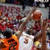 Iowa State forward Melvin Ejim shoots over Oklahoma State guard Markel Brown and Oklahoma State guard/forward Le\'Bryan Nash during the second half of an NCAA college basketball game Wednesday, March 6, 2013, at Hilton Coliseum in Ames, Iowa. Iowa State won the game 87-76. Ejim had 13 points and 12 rebounds. (AP Photo/Justin Hayworth) ORG XMIT: IAJH108