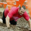 Nick Hamar crawls through a mud pit in the Juggernaut mud run at Mitch Park, in Edmond, OK, Saturday, September 29, 2012. The Juggernaut is part of a national mud run series to raise money for Susan G. Komen for the Cure. By Paul Hellstern, The Oklahoman