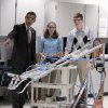FILE - In this Sept. 16, 2011 file photo, President Barack Obama, with students Meghan Clark, center, and Nathan Hughes, right, watches as they demonstrate their FIRST Robot, during a visits to a classroom at Thomas Jefferson High School for Science and Technology in Alexandria, Va. America\'s decision to re-elect President Barack Obama over Republican presidential candidate, former Massachusetts Gov. Mitt Romney will impact key sectors of the American economy. During the President\'s first term, Obama signed into law the America Invents Act to streamline the U.S. patent process. The idea was that inventors and entrepreneurs could turn their ideas into products more quickly and create inexpensive ways to resolve disputes(AP Photo/Pablo Martinez Monsivais, File)