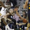Photo - Utah Jazz guard Gordon Hayward (20) tries to get around New Orleans Pelicans guard Anthony Morrow (3) in the first half of an NBA basketball game in New Orleans, Friday, March 28, 2014. (AP Photo/Bill Haber)