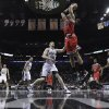 Photo - Chicago Bulls' Joakim Noah (13) scores over San Antonio Spurs defender Matt Bonner (15)during the first half of an NBA basketball game on Wednesday, March 6, 2013, in San Antonio. (AP Photo/Eric Gay)