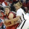 Louisville\'s Sara Hammond, left, tries to keep the ball away from Purdue\'s Taylor Manuel, during the second half of their second round game in the women\'s NCAA college basketball tournament in Louisville, Ky., Tuesday March 26, 2013. Louisville defeated Purdue 76-63. (AP Photo/Timothy D. Easley)