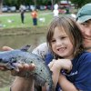 Kylie Adrianna Crouch looks at the catfish she reeled in with the help of her dad, Phillip Crouch, during a youth fishing clinic at Joe B. Barnes Regional Park. OKLAHOMAN ARCHIVE PHOTO BY JIM BECKEL