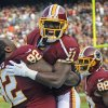 Photo -   Washington Redskins wide receiver Aldrick Robinson (11)celebrates his touchdown with defensive end Chris Baker (92) during the first half of an NFL football game against the Philadelphia Eagles in Landover, Md., Sunday, Nov. 18, 2012. (AP Photo/Nick Wass)