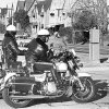 Photo - Two Oklahoma City police officers watch for speeders on N Robinson near NW 32 in this 1981 photo.  The Oklahoman archives