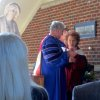 Dr. Robert Henry confers an OCU Honorary Doctor of Humane Letters degree on Bobbie Burbridge Lane. (Photo by Helen Ford Wallace).