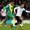 Photo - Norwich City's Martin Olsson, left, and Tottenham Hotspur's Aaron Lennon compete for the ball during their English Premier League soccer match at Carrow Road, Norwich, England, Sunday, Feb. 23, 2014. (AP Photo/Stephen Pond, PA Wire)    UNITED KINGDOM OUT   -  NO SALES   -   NO ARCHIVES