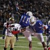 Millwood\'s Josh Turner (11) and Michael Cole (1) celebrate after a touchdown in front of Kingfisher\'s Rhett Blundell (I31) during the Class 2A State semifinal football game between Millwood High School and Kingfisher High School on Saturday, Dec. 5, 2009, in Yukon, Okla. Photo by Chris Landsberger, The Oklahoman