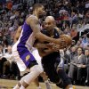 Memphis Grizzlies\' Jerryd Bayless, right, drives against Phoenix Suns\' Markieff Morris during the first half of an NBA basketball game on Wednesday, Dec. 12, 2012, in Phoenix. (AP Photo/Matt York)