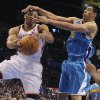 Oklahoma City Thunder point guard Russell Westbrook (0) is fouled by New Orleans Hornets power forward Gustavo Ayon (15) during the NBA basketball game between the Oklahoma City Thunder and the New Orleans Hornets at the Chesapeake Energy Arena on Wednesday, Jan. 25, 2012, in Oklahoma City, Okla. Photo by Chris Landsberger, The Oklahoman