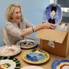 Marsha Funk, executive director for the Variety Care Foundation, unpacks decorated plates made by past patients as she settles into the group\'s new administrative offices, 3000 N Grand Boulevard in Oklahoma City, on Wednesday, May 9, 2012. Funk said the plates will eventually be displayed in the building\'s lobby. Photo by Jim Beckel, The Oklahoman
