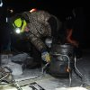 Iditarod musher Jeff King, from Denali, Alaska, adds heat to his dog food cooker after arriving first into the White Mountain checkpoint during the Iditarod Trail Sled Dog Race on Monday, March 10, 2014. (AP Photo/The Anchorage Daily News, Bob Hallinen)