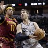 Photo - San Antonio Spurs' Tiago Splitter (22), of Brazil, works the ball around Cleveland Cavaliers' Anderson Varejao (17) during the first half of an NBA basketball game Saturday, Nov. 23, 2013, in San Antonio. (AP Photo/Eric Gay)