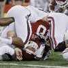 Oklahoma\'s Blake Bell (10) is rolled up short of the endzone during the college football Cotton Bowl game between the University of Oklahoma Sooners (OU) and Texas A&M University Aggies (TXAM) at Cowboy\'s Stadium on Friday Jan. 4, 2013, in Arlington, Tx. Photo by Chris Landsberger, The Oklahoman