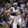 Photo - Miami Heat's LeBron James, middle, and Indiana Pacers' David West (21) watch the ball get away during the first half of an NBA basketball game, Friday, April 11, 2014, in Miami. (AP Photo/Lynne Sladky)