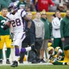 Photo - Minnesota Vikings running back Adrian Peterson breaks a for an 82-yard touchdown run during the first half of an NFL football game against the Green Bay Packers Sunday, Dec. 2, 2012, in Green Bay, Wis. (AP Photo/Tom Lynn)