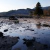 Photo - Water and mud back up on the east side of Saturday's fatal mudslide near Oso, Wash., Sunday March 23, 2014. (AP Photo /The Herald, Genna Martin)