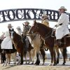 Photo - The U.S. Marshall's Posse watches over the celebration as Stockyards City Main Street celebrates the completion of their new archway at the entrance to Stockyards City in Oklahoma City, OK, Thursday, Feb. 18, 2010. By Paul Hellstern, The Oklahoman