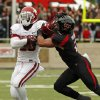Oklahoma\'s Damien Williams (26) tries to fight off Texas Tech\'s Cornelius Douglas (2) during a college football game between the University of Oklahoma (OU) and Texas Tech University at Jones AT&T Stadium in Lubbock, Texas, Saturday, Oct. 6, 2012. OU won, 41-20. Photo by Nate Billings, The Oklahoman