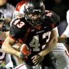 Owasso\'s defense tries to stop Westmoore\'s Cody Feuerborn during their playoff game at Moore High School in Moore, Oklahoma, on Friday Nov. 19, 2010. Photo by John Clanton, The Oklahoman