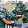 Edmond Santa Fe\'s Taylor Ashcraft (28), Daniel Bly (13) and Conner Bays celebrate a touchdown during the high school football game between Edmond Santa Fe and Edmond Memorial at Wantland Stadium in Edmond, Okla., Friday, Sept. 2, 2011. Photo by Sarah Phipps, The Oklahoman