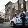 Police guard the apartment building where the sister of the Boston marathon bombing suspects is believed to live, Friday, April 19, 2013, in West New York, N.J. Federal investigators had removed items from the house earlier in the day, although there is no indication that the sister was involved in the bombing. (AP Photo/John Minchillo) ORG XMIT: NJJM101
