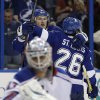 Tampa Bay Lightning center Steven Stamkos (91) celebrates with teammate right wing Martin St. Louis (26) after scoring against the New York Rangers during the second period of an NHL hockey game on Saturday, Feb. 2, 2013, in Tampa, Fla. (AP Photo/Chris O\'Meara)
