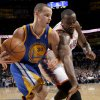 Oklahoma City\'s Kendrick Perkins (5) defends Golden State\'s Stephen Curry (30) during the NBA basketball game between the Oklahoma City Thunder and the Golden State Warriors at the Oklahoma City Arena, Tuesday, March 29, 2011. Photo by Bryan Terry, The Oklahoman