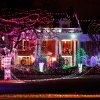 An eye-catching, car-stopping lighting display illuminates yards of three neighboring houses on Grand Boulevard in Nichols Hills . December 18, 2011 Photo by Jim Beckel, The Oklahoman