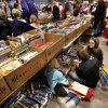 As shoppers browse, these Murphree siblings, Kristen, 8, Brendan, 13, and Alyssa, 11, sit on the floor beneath a book-laden table. Several thousand bibliophiles and bargain hunters crowded into Oklahoma Expo Hall at State Fair Park on Saturday, Feb. 23, 2013, in a quest to find reading material at deeply discounted prices. Friends of the Metropolitan Library System is holding their much-anticipated annual book sale this weekend. The sale continues Sunday from 9 a.m. to 5:30 p.m. Photo by Jim Beckel, The Oklahoman