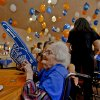 O\'Dell Medley wears a foam hand to show support for the Thunder as she prepares to play bingo during the Oklahoma City Thunder\'s 1000th community appearance at Ranchwood Nursing Home on Tuesday, Nov. 27, 2012, in Yukon, Okla. Photo by Chris Landsberger, The Oklahoman
