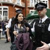Photo -   British police officers move a protester in support of WikiLeaks founder Julian Assange from the front of Ecuadorian Embassy in central London, London, Thursday, Aug. 16, 2012. WikiLeaks founder Julian Assange entered the embassy in June in an attempt to gain political asylum to prevent him from being extradited to Sweden, where he faces allegations of sex crimes, which he denies. (AP Photo/Sang Tan)
