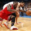 Chicago\'s Nate Robinson (2) and Oklahoma City\'s Thabo Sefolosha (2) fight for a loose ball during the NBA game between the Oklahoma City Thunder and the Chicago Bulls at Chesapeake Energy Arena in Oklahoma City, Sunday, Feb. 24, 2013. Photo by Sarah Phipps, The Oklahoman