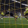 Photo - Moenchengladbach's Raffael of Brazil, second from right, scores  during the German first division Bundesliga soccer match between BvB Borussia Dortmund and VfL Borussia Moenchengladbach in Dortmund, Germany, Saturday, March 15, 2014. (AP Photo/Frank Augstein)