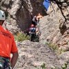 Photo - This photo provided by the Poudre Fire Authority shows search and rescue teams carrying a rescued hiker from the side of a hill Monday, Aug. 18, 2014 after she fell and spent about three hours in a crevice near a popular hiking trail in northern Colorado. More than 40 people worked to pull the 16-year-old girl from the crevice on Horsetooth Rock in the Horsetooth Mountain Open Space on Monday. (AP Photo/Poudre Fire Authority)