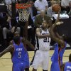 San Antonio\'s Tim Duncan (21) goes to the basket between Oklahoma City\'s Kendrick Perkins (5), James Harden (13), and Serge Ibaka (9) during Game 2 of the Western Conference Finals between the Oklahoma City Thunder and the San Antonio Spurs in the NBA playoffs at the AT&T Center in San Antonio, Texas, Tuesday, May 29, 2012. Oklahoma City lost 120-111. Photo by Bryan Terry, The Oklahoman