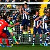 Photo - West Bromich Albion defenders try to block the free kick from Liverpool's Luis Suarez's during their English Premier League soccer match at The Hawthorns stadium in West Bromwich, England, Sunday, Feb. 2, 2014. (AP Photo/Rui Vieira)